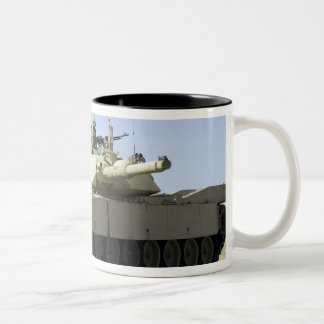 US Marines provide security in a battle tank Coffee Mug