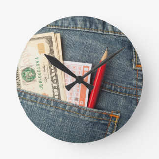 US money and lottery bet slip in pocket Round Clock