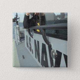 US Navy Boatswain's Mate looks through binocula Pinback Button