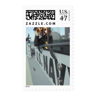 US Navy Boatswain's Mate looks through binocula Postage