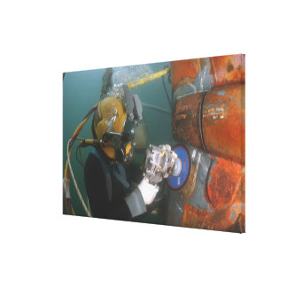 US Navy Diver uses a grinder Canvas Print