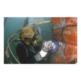 US Navy Diver uses a grinder Photo Print