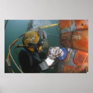 US Navy Diver uses a grinder Poster