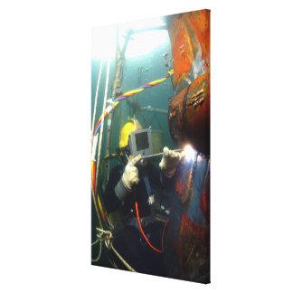 US Navy Diver welds a repair patch Canvas Print