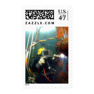 US Navy Diver welds a repair patch Postage