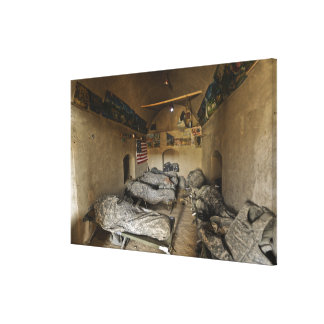 US Soldiers sleep in an abandoned mud house Canvas Print