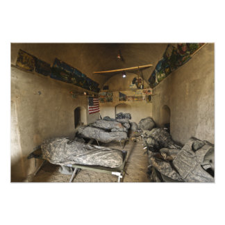 US Soldiers sleep in an abandoned mud house Photo Print