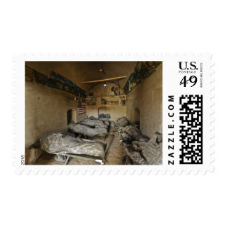 US Soldiers sleep in an abandoned mud house Postage Stamp