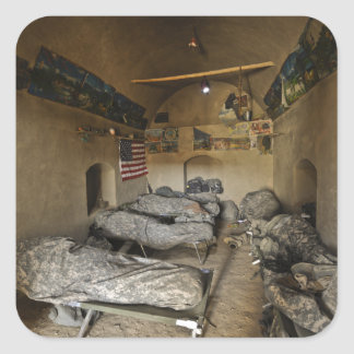 US Soldiers sleep in an abandoned mud house Square Sticker