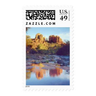 USA, Arizona, Sedona. Cathedral Rock reflecting Stamps