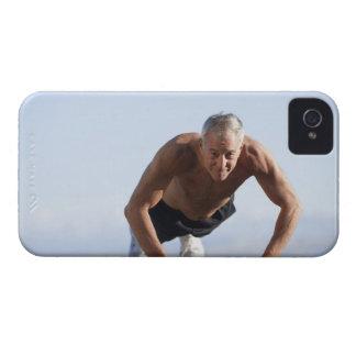 USA, California, Berkeley, Senior man exercising Case-Mate iPhone 4 Case