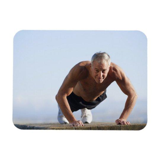 USA, California, Berkeley, Senior man exercising Magnet