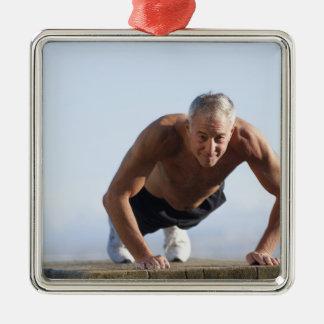 USA, California, Berkeley, Senior man exercising Metal Ornament