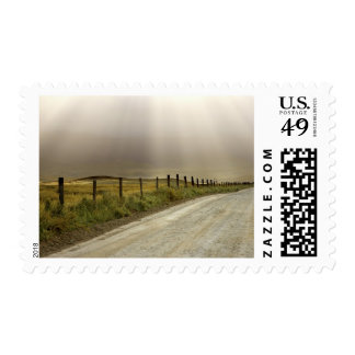 USA, California. Country road lit by sun rays. Postage