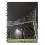 USA, California, Ladera Ranch, Football player Spiral Note Books