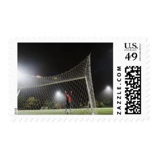 USA, California, Ladera Ranch, Football player Stamp
