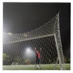 USA, California, Ladera Ranch, Football player Large Square Tile