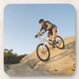 USA, California, Laguna Beach, Man cycling down Beverage Coaster