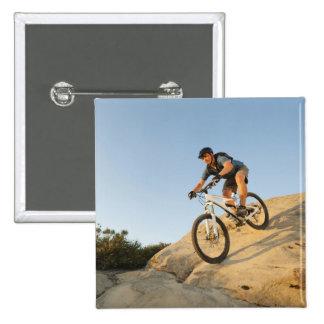 USA, California, Laguna Beach, Man cycling down Button