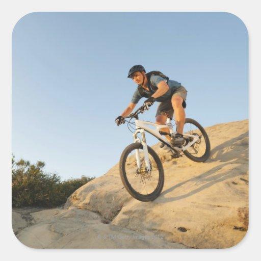USA, California, Laguna Beach, Man cycling down Square Sticker
