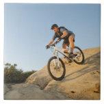 USA, California, Laguna Beach, Man cycling down Large Square Tile
