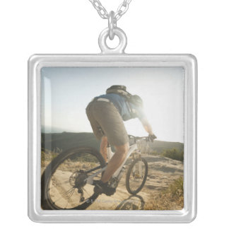 USA, California, Laguna Beach, Mountain biker Silver Plated Necklace