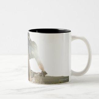 USA, California, Laguna Beach, Mountain biker Two-Tone Coffee Mug