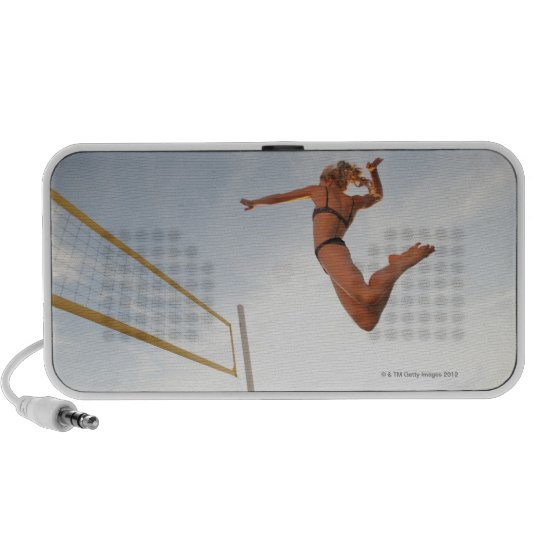 USA, California, Los Angeles, woman playing 2 Portable Speaker