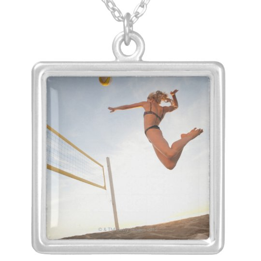 USA, California, Los Angeles, woman playing 2 Silver Plated Necklace