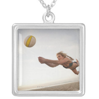 USA, California, Los Angeles, woman playing Silver Plated Necklace