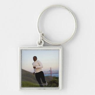 USA, California, San Francisco, Woman jogging, Keychain
