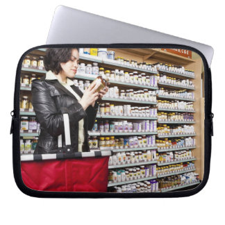 USA, California, San Rafael, Woman shopping in Laptop Sleeve