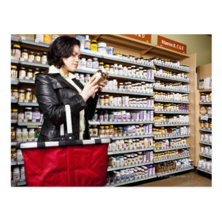 USA, California, San Rafael, Woman shopping in Post Cards