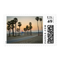 USA, California, Santa Monica Pier at sunset Postage