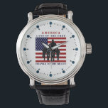 """USA Flag Soldiers Land of Free Watch<br><div class=""""desc"""">Patriotic USA &quot;Land of the Free, Thanks to the Brave&quot; marching soldiers silhouette wrist watch. These watches feature an American flag in the center with marching soldiers silhouette in front. The watch also reads &quot;Land of the Free, thanks to the Brave&quot;! This watch will surely add some patriotic pride and...</div>"""