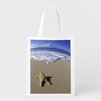 USA, Hawaii, Maui, Makena Beach, Starfish and Reusable Grocery Bag