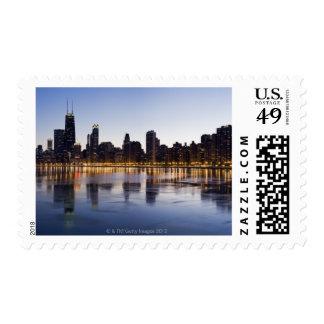 USA, Illinois, Chicago, City skyline over Lake 6 Postage