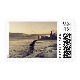 USA, Illinois, Chicago, Skyline at sunrise Postage