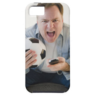 USA, Jersey City, New Jersey, man holding remote iPhone 5 Cases