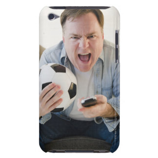 USA, Jersey City, New Jersey, man holding remote iPod Touch Covers