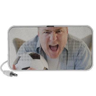 USA, Jersey City, New Jersey, man holding remote Notebook Speaker