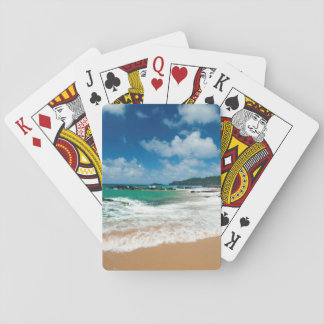 USA, Kauai, Hawaii. A Woman Strolls The Rocks Playing Cards