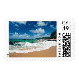 USA, Kauai, Hawaii. A Woman Strolls The Rocks Postage
