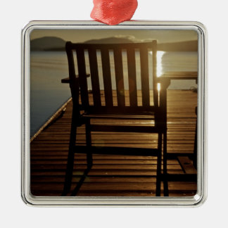 USA, Maine, Rockwood. A chair with a view of Metal Ornament
