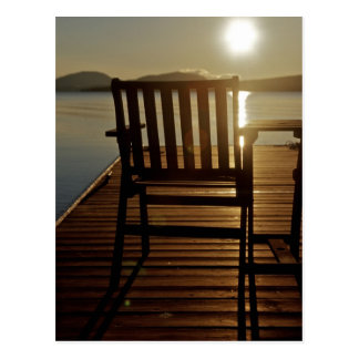 USA, Maine, Rockwood. A chair with a view of Postcard