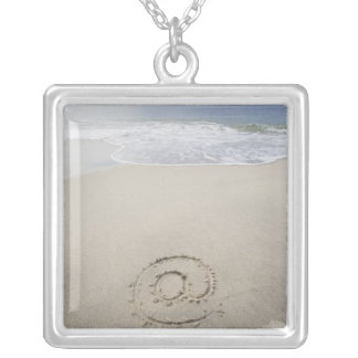 USA, Massachusetts, At sign drawn on sandy beach Silver Plated Necklace