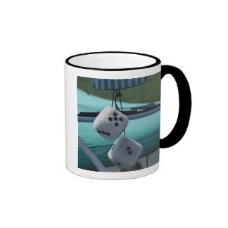 USA, Massachusetts, Gloucester. Fuzzy dice in a Ringer Mug