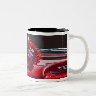USA, Massachusetts, Gloucester. Fuzzy dice with Two-Tone Coffee Mug