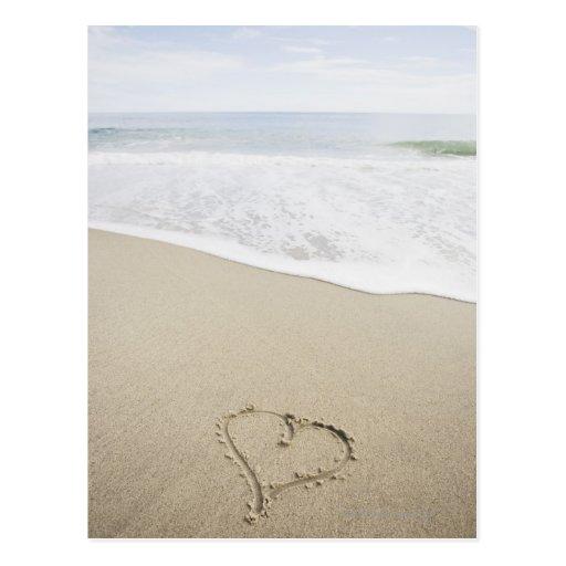 USA, Massachusetts, Hearts drawn on sandy beach Postcard