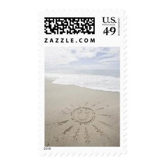 USA, Massachusetts, Sun drawn on sandy beach Postage